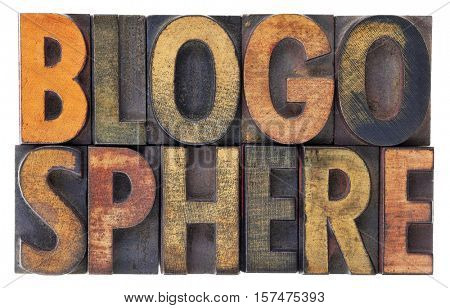 blogosphere (global blog community) word abstract in vintage wood letterpress types, stained by ink, isolated on white