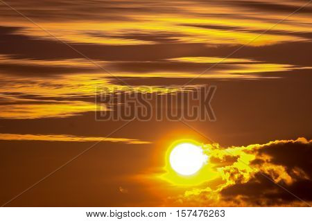 sunset in autumn in November, a bright yellow, brown and black, round the sun in the sky, clouds heavy different sizes, sunset, autumn, yellow, black, brown, sky, sun, clouds, heavy, dark, round, November, nature, natural, beautiful, shiny