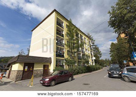 ZAKOPANE POLAND - SEPTEMBER 23 2016: Multi-family residential building was built on a side street in the downtown.