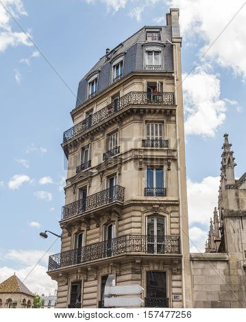 PARIS FRANCE - 29TH JULY 2016: A view of architecture in Paris from street level that is flat on one side.