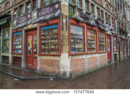 GHENT BELGIUM 18TH FEBRUARY 2016: The outside of a beer store in Ghent. Large amounts of beer can be seen on display.