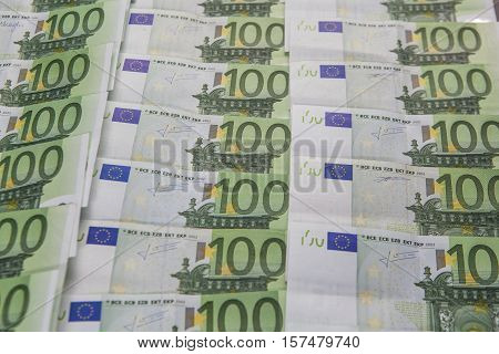 Background full with money hundred euro bills ordered in columns and rows selected focus