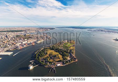 Aerial View Of The Governors Island With Brooklyn In The Background