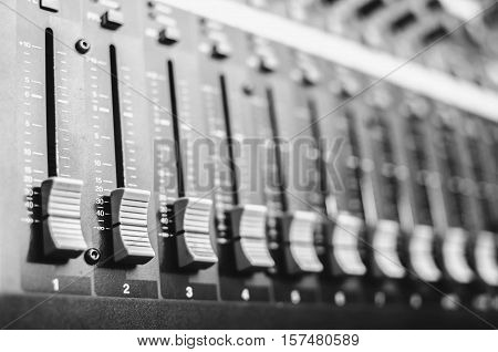 the sliders mixing console closeupwith audio and effects the distribution of the input channels output volume