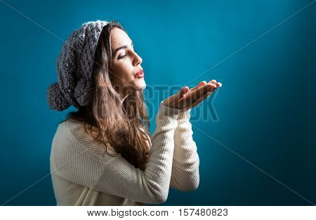Happy Young Woman Blowing A Kiss