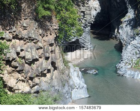 The rocks and river of Alcantara Gorge in May, Sicily, Italy