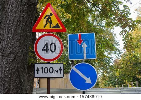 street traffic signs on a background of green foliage