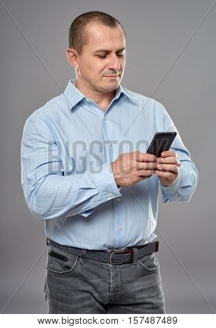 Businessman Texting On His Cellphone