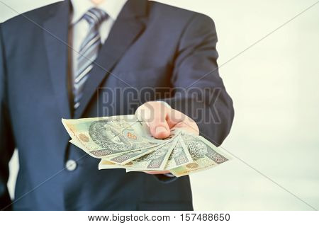 Range Of Polish Banknotes In Businessman Hand