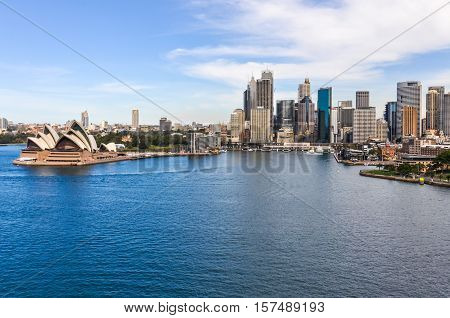 SYDNEY, AUSTRALIA - AUGUST 29, 2012: View of the Opera House and the Central Business District from the Harbor Bridge in Sydney Australia