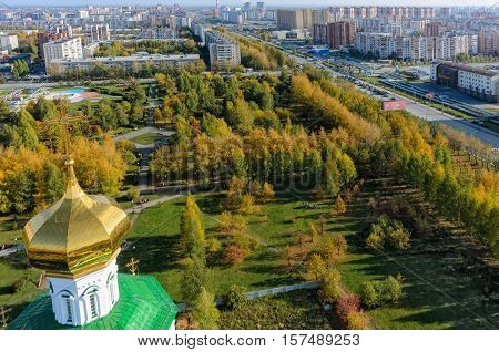 Tyumen, Russia - September 26, 2016: Bird eye view on cross of temple chapel in Lady Day honor and Square of Deputies