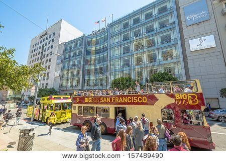 San Francisco, California, United States - August 17, 2016: the Big Bus, Hop On Hop Off, Sightseeing Tour, the popular double-decker bus carrying tourists, standing in Union Square in San Francisco.