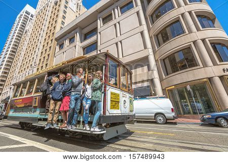San Francisco, California, United States - August 17, 2016: The popular Cable Car of San Francisco, Powell-Mason Lines, full of tourists, near Union Square, downtown San Francisco.