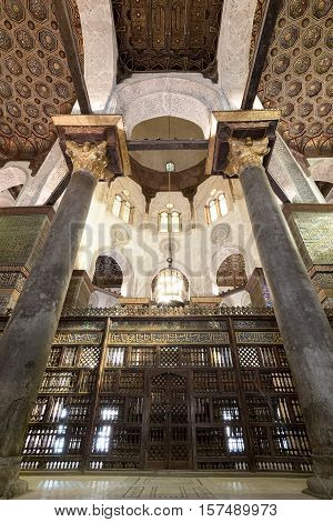 Cairo, Egypt - November 19 2016: Interior view of mashrabiya screens around the cenotaph in the mausoleum of Sultan Qalawun, part of Sultan Qalawun Complex built in 1285 AD, Al Moez Street, Old Cairo