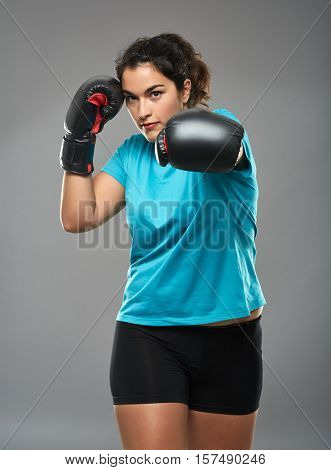 Latino Female Fighter Delivering A Jab
