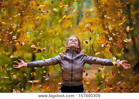 Young Lady Throwing Up Leaves