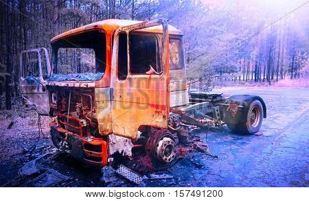 Road accident. Careless driver destroy truck on icing highway. Filtered picture with added sun rays for dramatic feeling.