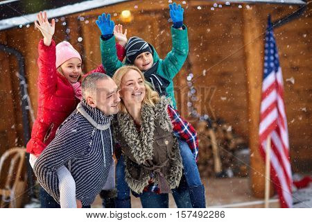 portrait young family enjoying on snowy day