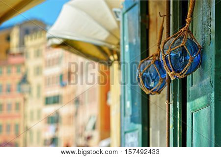 two glasses buoys on wood door at the street blured background