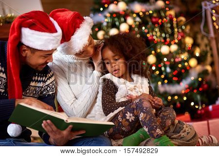 Afro American young family spending time together for Christmas