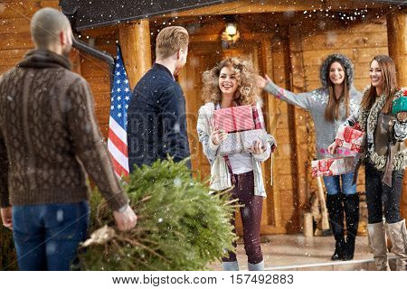 Young female welcomes guests for Christmas holidays