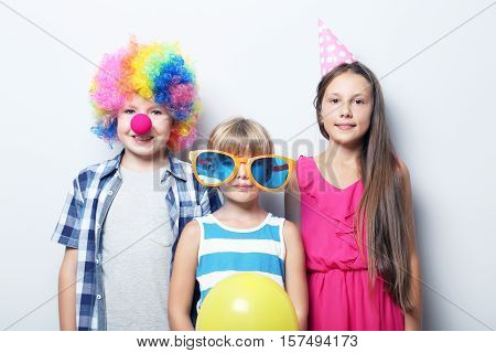 Portrait of childrens on a grey background