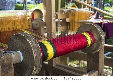 spool of thread for the old loom with shallow depth of field