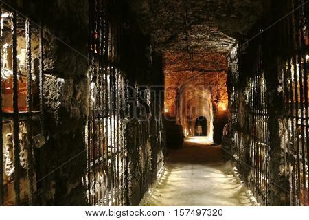 Old wine cave with archs and wine bottles in Mala Trna village Tokaj valley Slovakia.