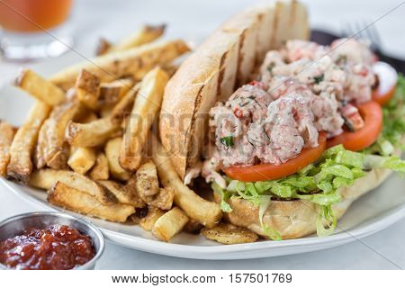 A Lobster Po' Boy sandwich and fries