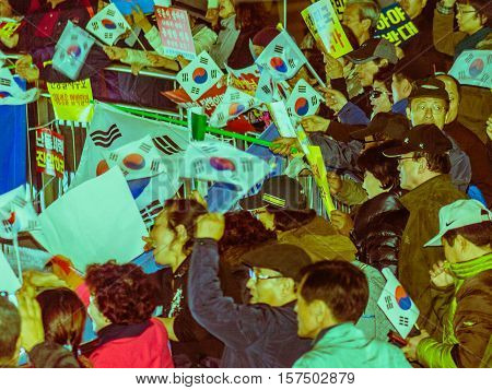 SEOUL, SOUTH KOREA, NOVEMBER 19,2016 Group of protesters outside Seoul Station rally against impeachment of President Park Geun-hye