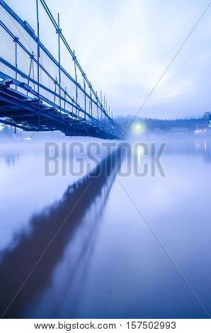 floating bridge in the fog. rustic bridge in fog. rural bridge in fog. Bridge in dense fog