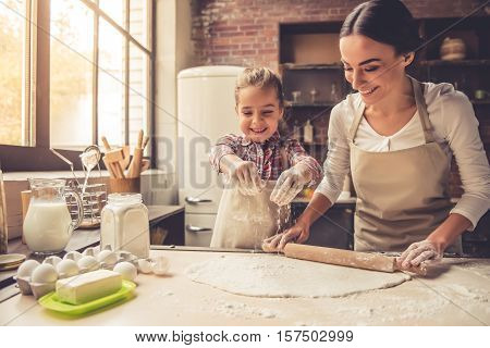 Mom And Daughter Baking
