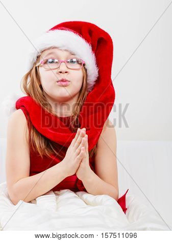 Girl In Santa Hat Making Silly Face