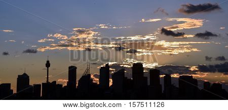 The sunset slowly goes down at Bradley's Head, Sydney, Australia. Sydney Harbour ocean water wide panoramic view on the CBD city at Sunset.