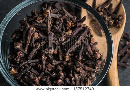 Glass Bowl Of Cloves With Wooden Spoon Off To The Side