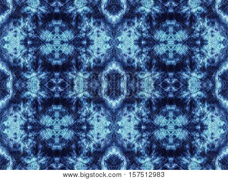 Hand-dyed indigo and light blue fabric bleached with zig zag stitch detail and in a seamless repeat pattern