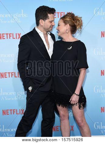 LOS ANGELES - NOV 18:  Nick Holmes and Virginia Madsen arrives to the Netflix's 'Gilmore Girls: A Year In The Life' Premiere on November 18, 2016 in Westwood, CA