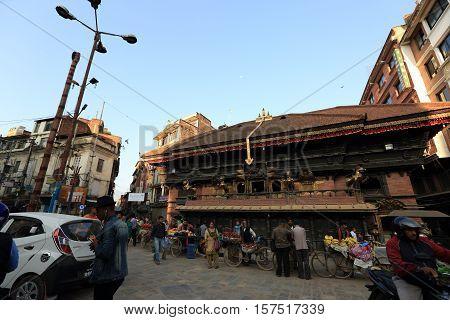 KATHMANDU NEPAL - OCT 20 2016: Nepali people on the Thamel street in the morning in Kathmandu Nepal