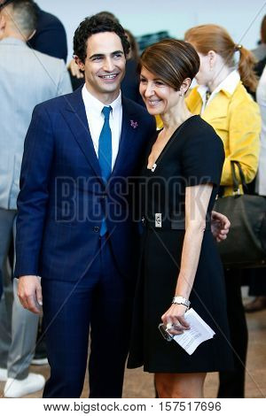 NEW YORK-MAY 5: Zac Posen (L) and Nancy Chilton attend the ribbon cutting ceremony for the Anna Wintour Costume Center Grand Opening at the Metropolitan Museum of Art on May 5, 2014 in New York City.