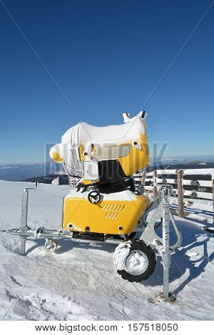 High power snow gun on the top of the mountain ready for action close up view vertical orientation