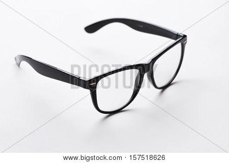 Black-rimmed glasses on white background