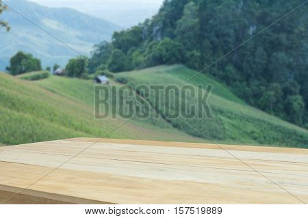 empty wood table for product display with nature background