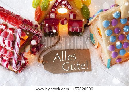 Label With German Text Alles Gute Means Best Wishes. Colorful Gingerbread House On Snow And Snowflakes. Christmas Card For Seasons Greetings