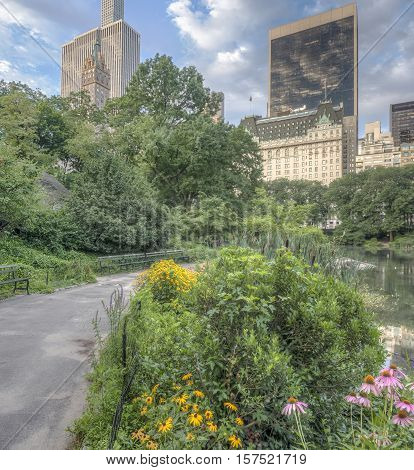 Central Park New York City near 59th street in mid summer with flowers on lake