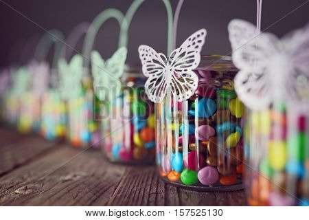 Chocolate candies in jars for wedding favours or holiday decoration