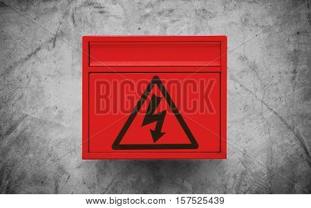 High voltage sign symbol, on red electronic box on concrete wall texture background