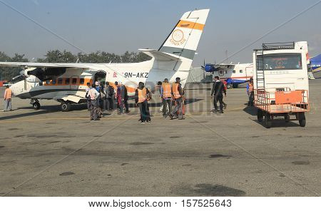 KATHMANDU/NEPAL - OCTOBER 30 2016: Goma Air small plane getting redy for take off to Lukla. passangers getting on small plane in Tribhuvan International Airport of Kathmandu.