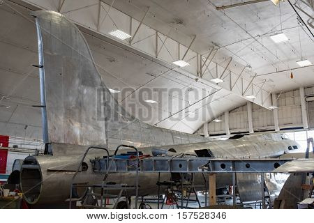 DAYTON, OHIO, USA-NOVEMBER 18, 2016: National Museum USAF is restoring the famous original WWII Memphis Belle B-17F Flying Fortress bomber, shown here with tail stabilizer & wing in restoration area.