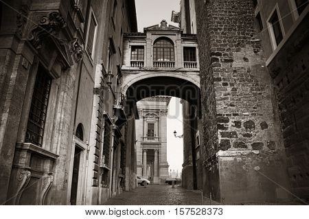 Street view with archway near city hall in Rome, Italy.