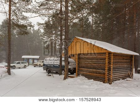 Baikal, Russia - March 06, 2016: Wooden house with administration at the entrance of Trans-Baikal National Park.
